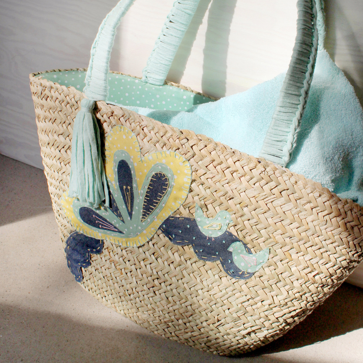 Beach bag with fabric appliqués