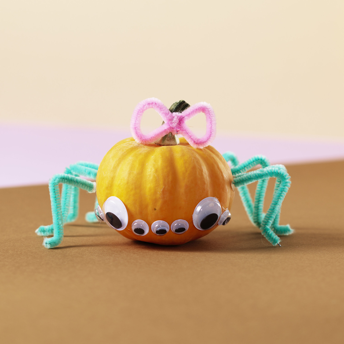 Make a scary pumpkin spider