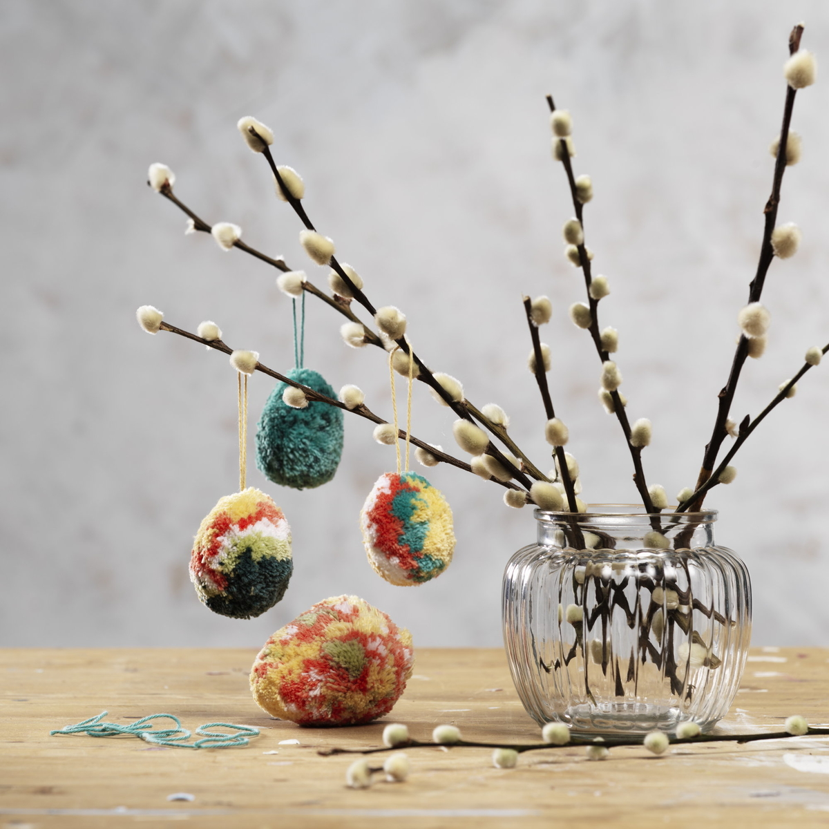 Decorate with fluffy pompom eggs